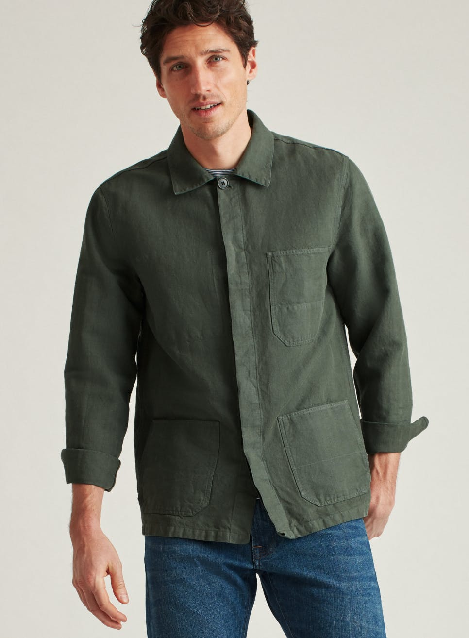 man wearing an olive colored casual shirt