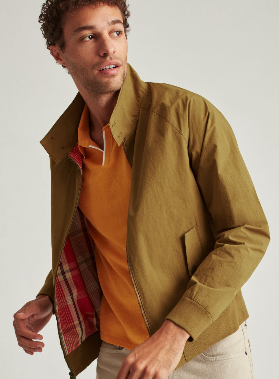 man wearing olive cardigan blazer