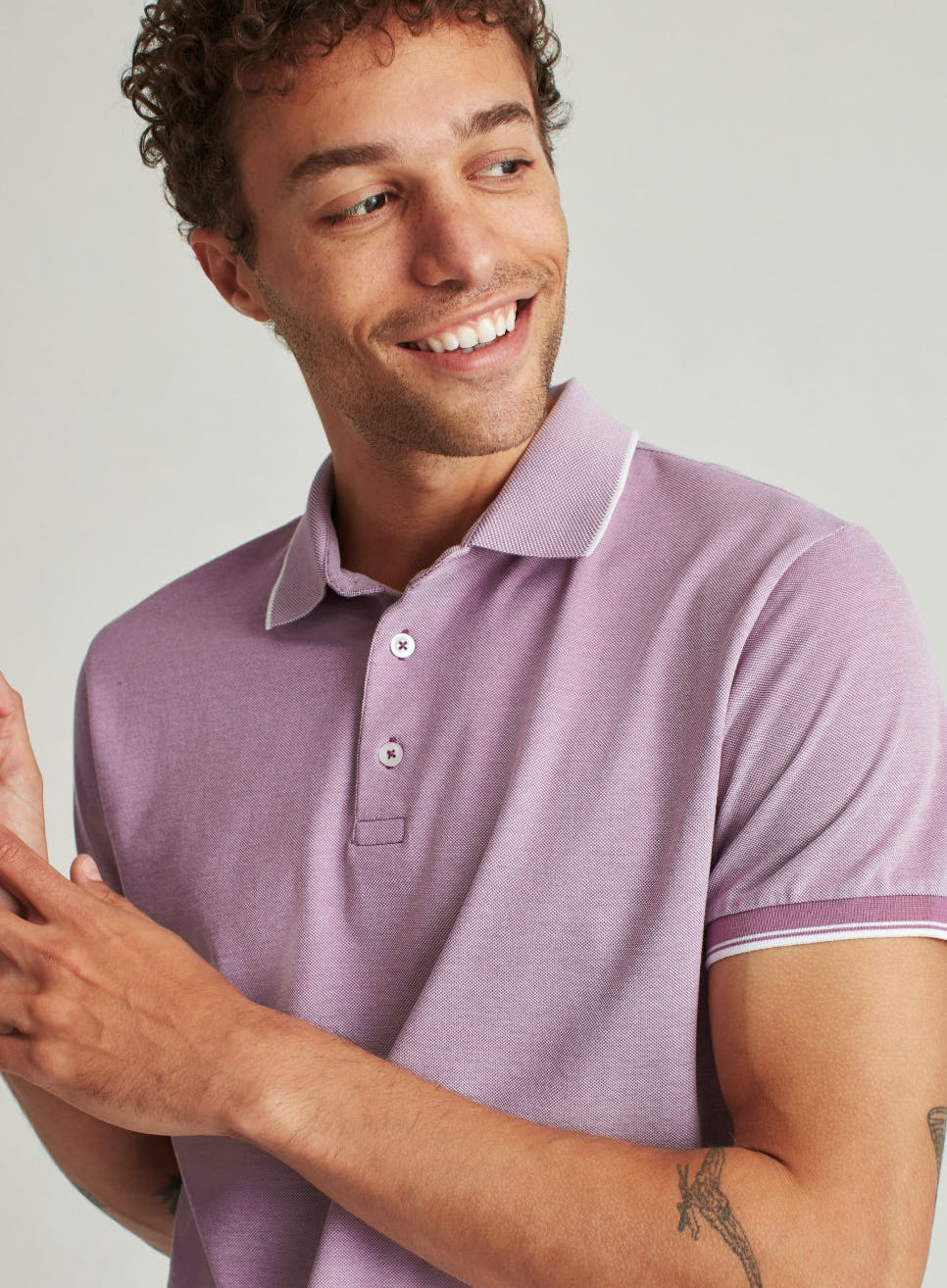 image of man wearing a purple pique polo