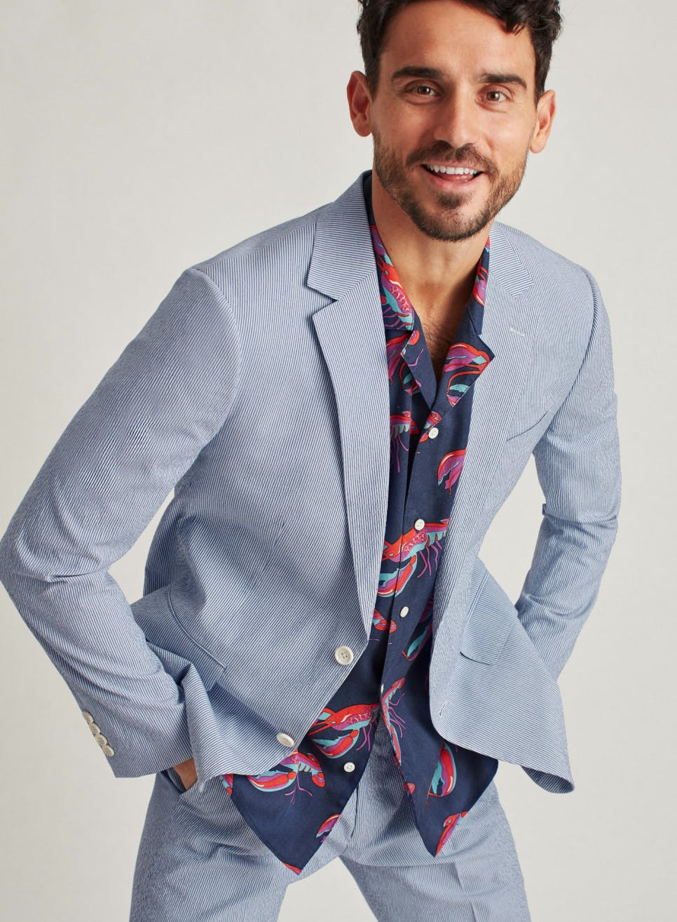 Image of model in lightweight suit with casual lobster shirt