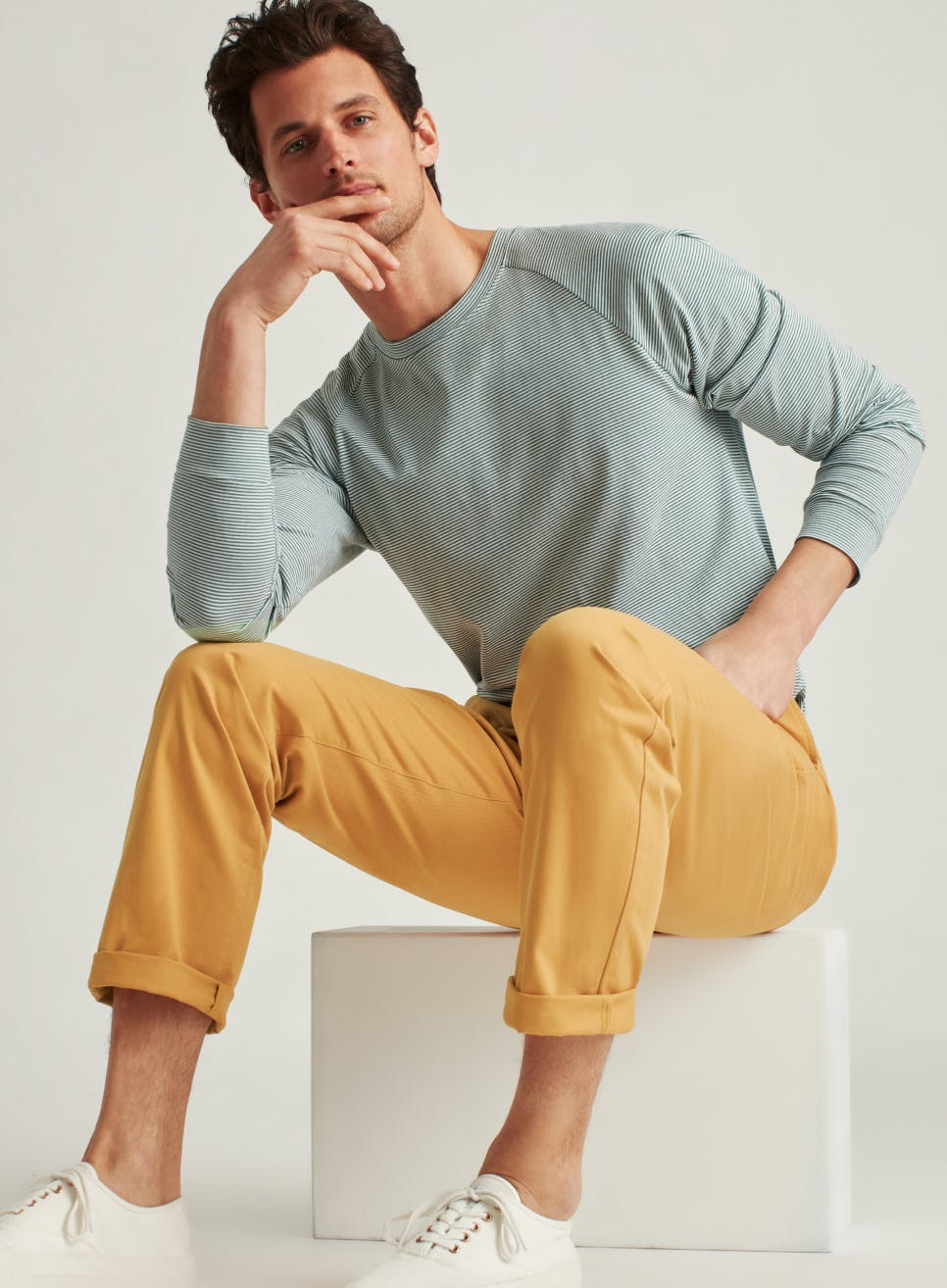 image of model in golden oak chinos