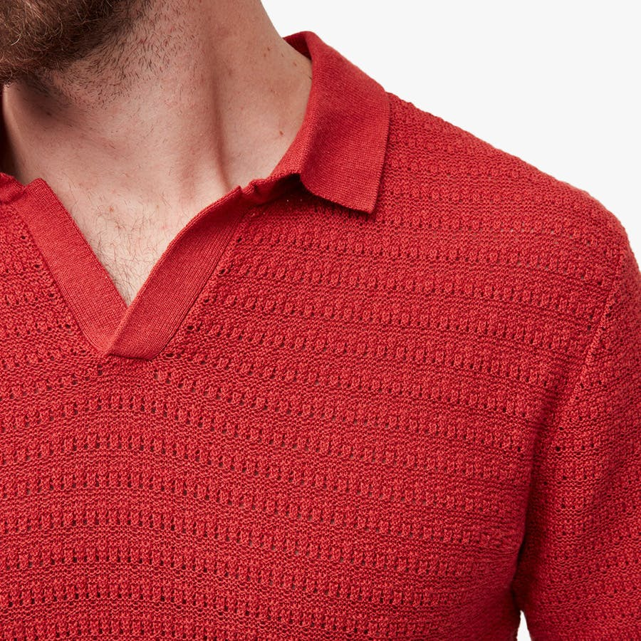 Closeup of red johnny collar polo