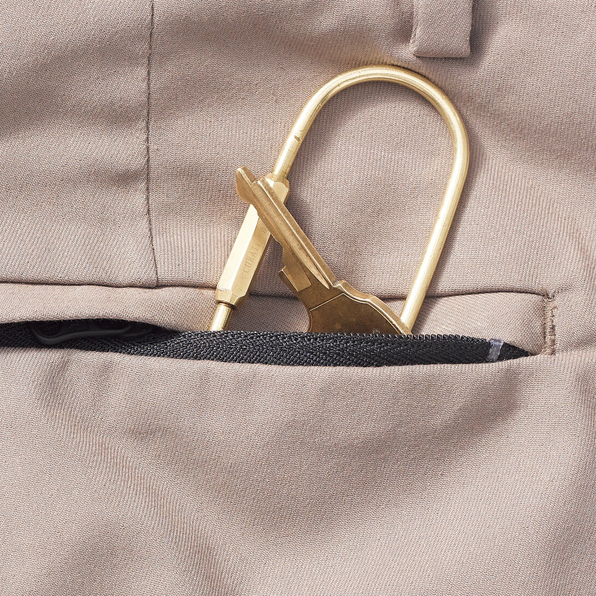 close up image of black tech chinos