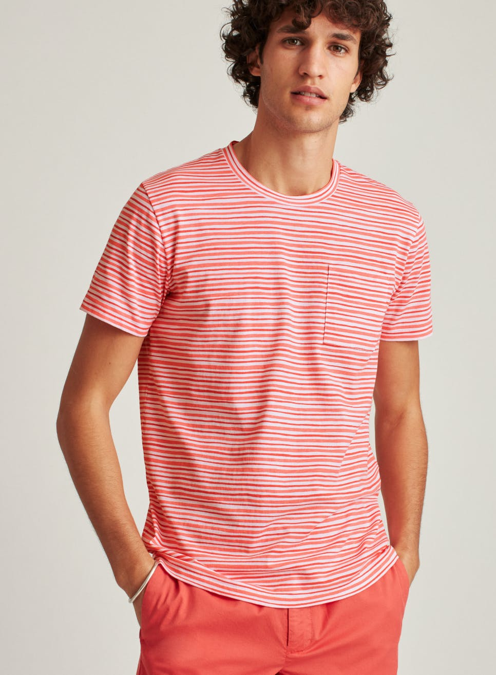 image of model in red stripe tee