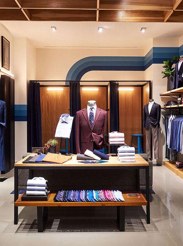 Image of Dress Shirts and Suit Ties on Display