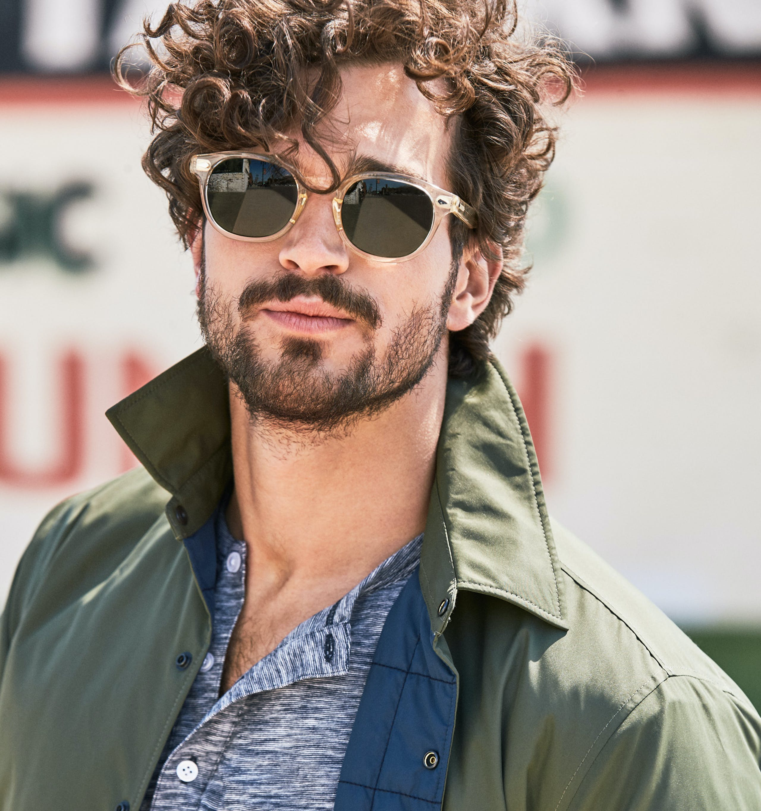 Image of man wearing bonobos outerwear and sunglasses.