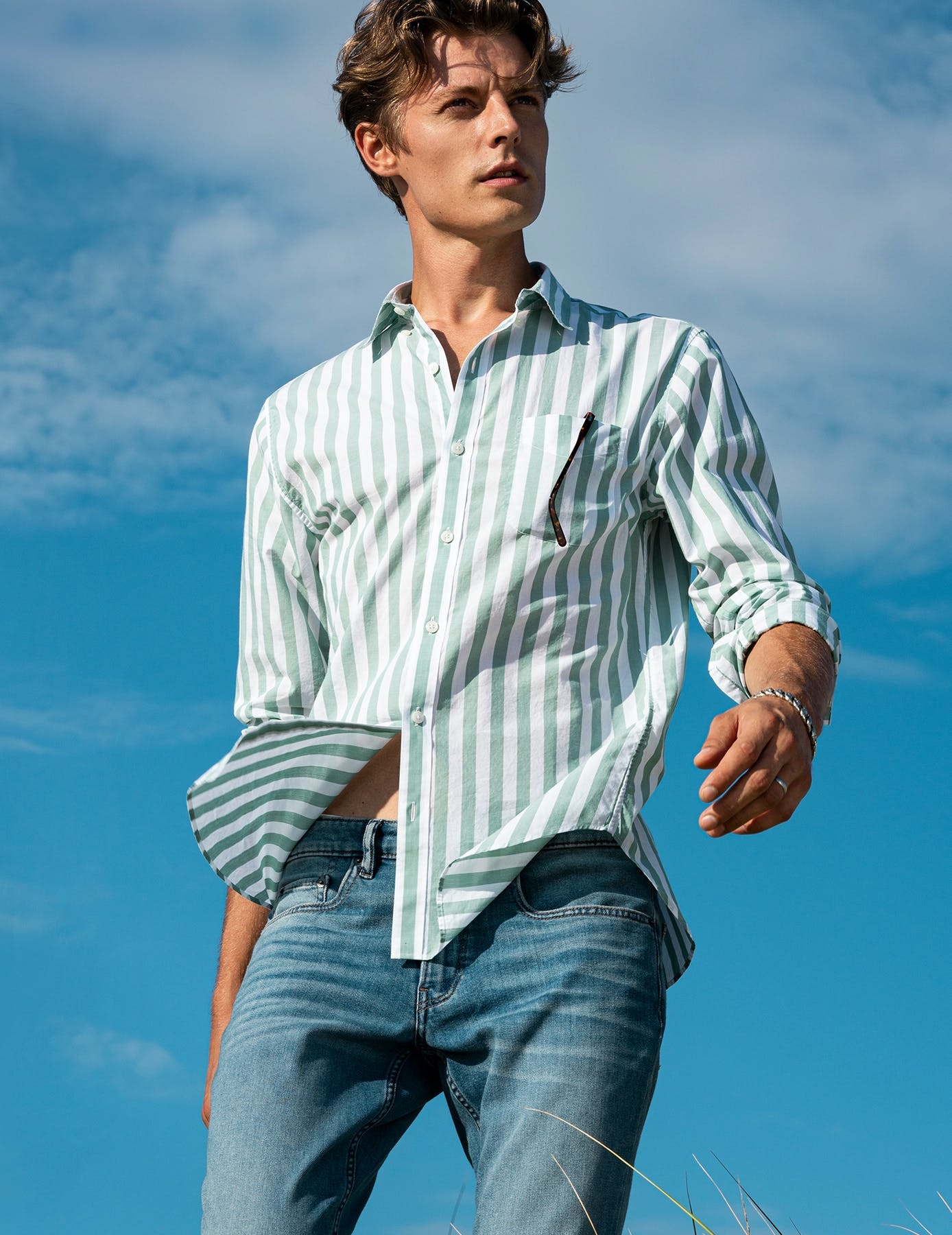 Man wearing green lightweight button down shirt