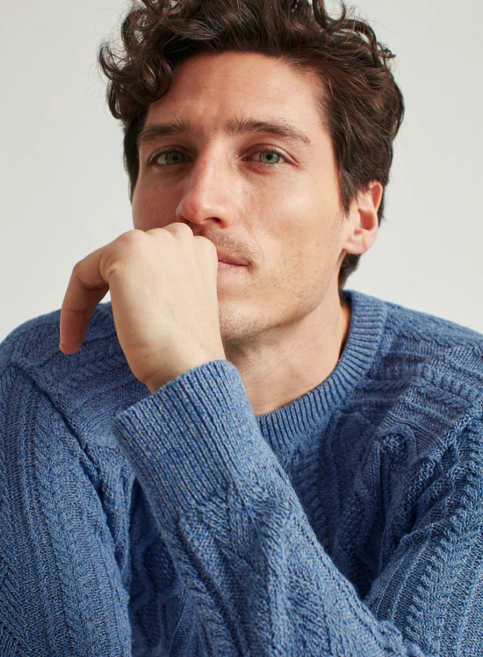man wearing a blue sweater