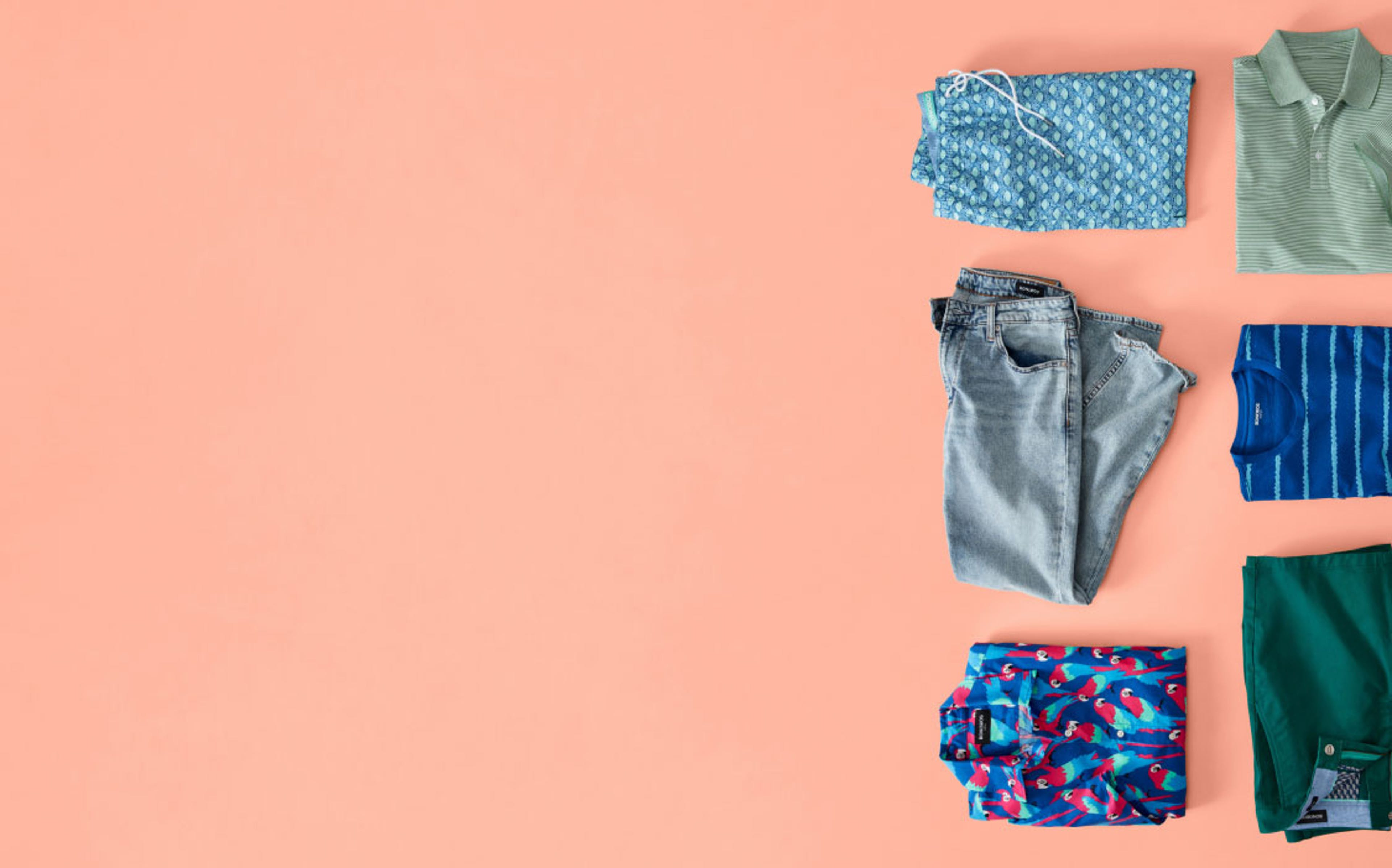 image of folded clothes on peach background