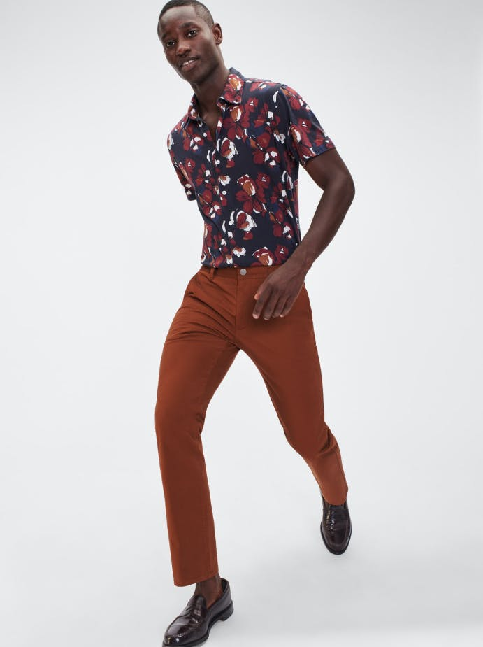 Man wearing floral shirt and brown chinos