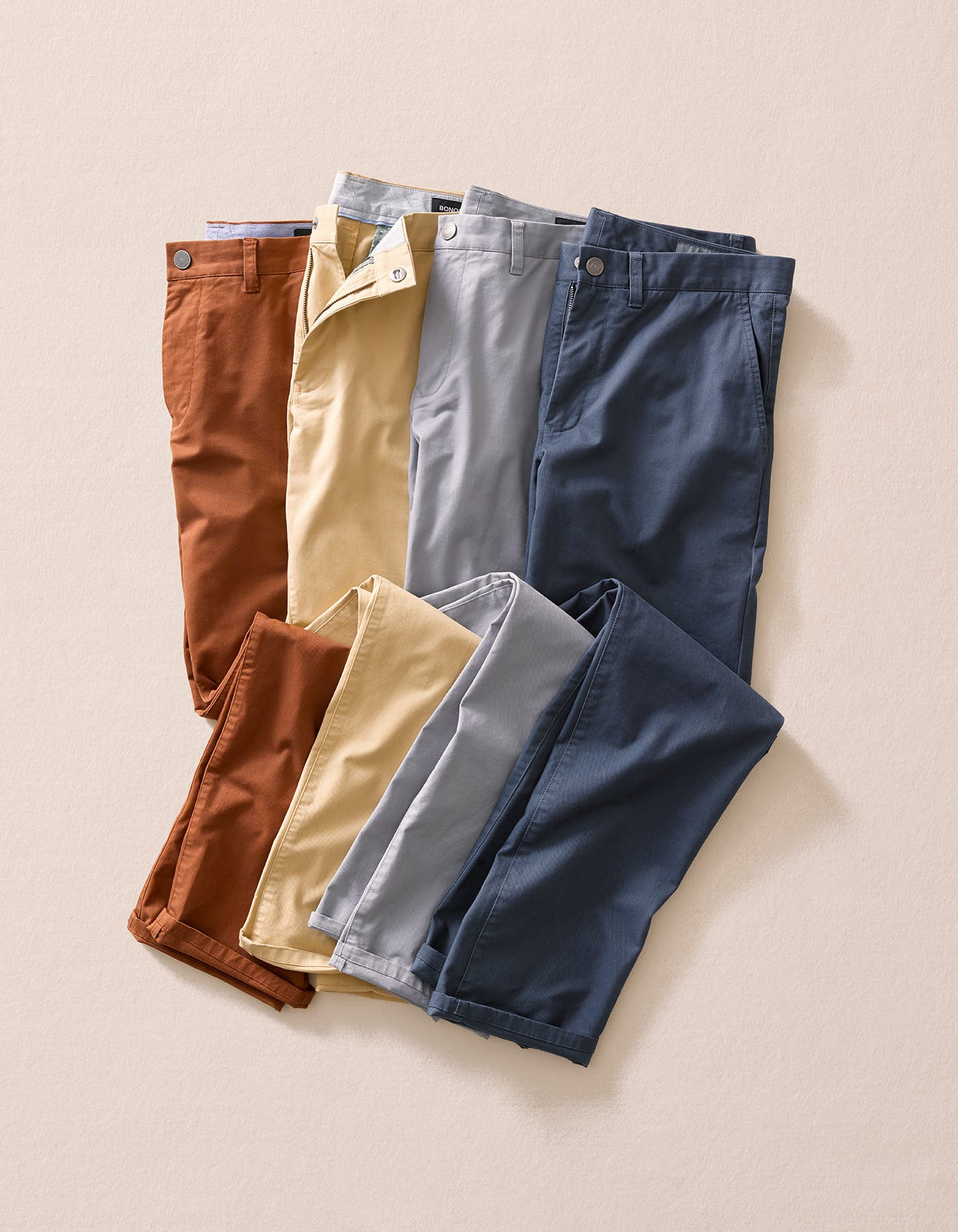 Image of different color chinos next to each other