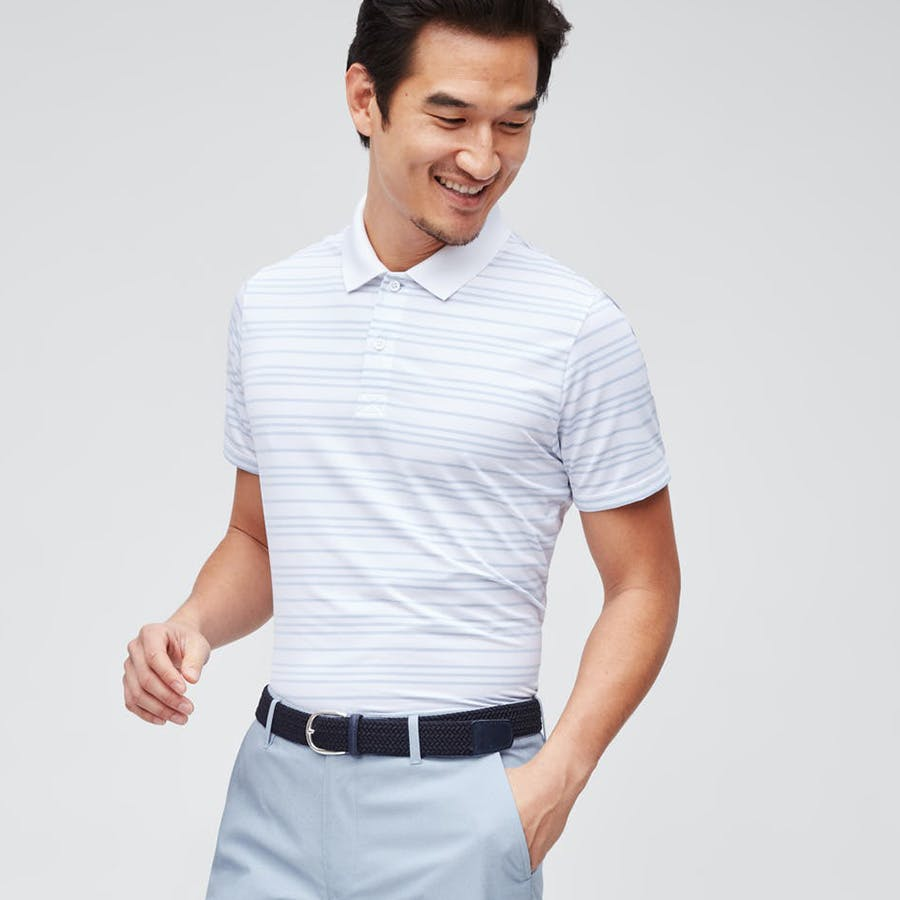 Man wearing golf polo, pants, and belt