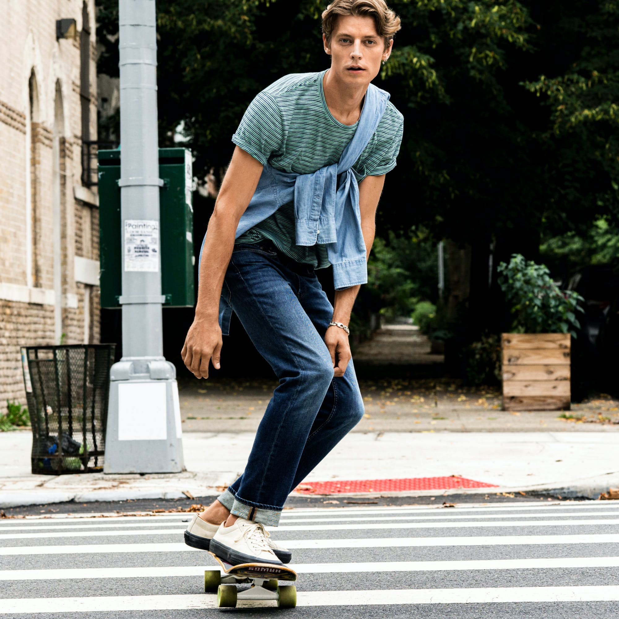 Man wearing lightweight Jeans skateboarding